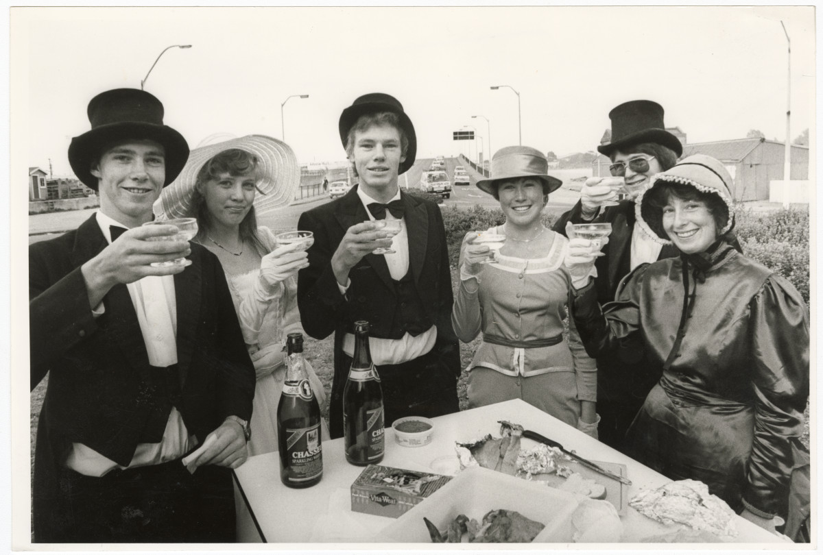 Black and white photo showing University students champagne breakfast on roundabout. 1983