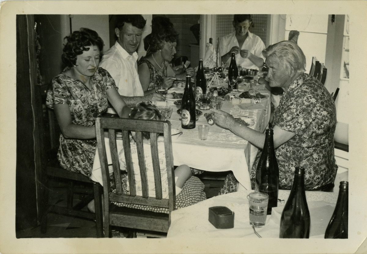 Black and white photo of a family at the Christmas dinner table, 1962