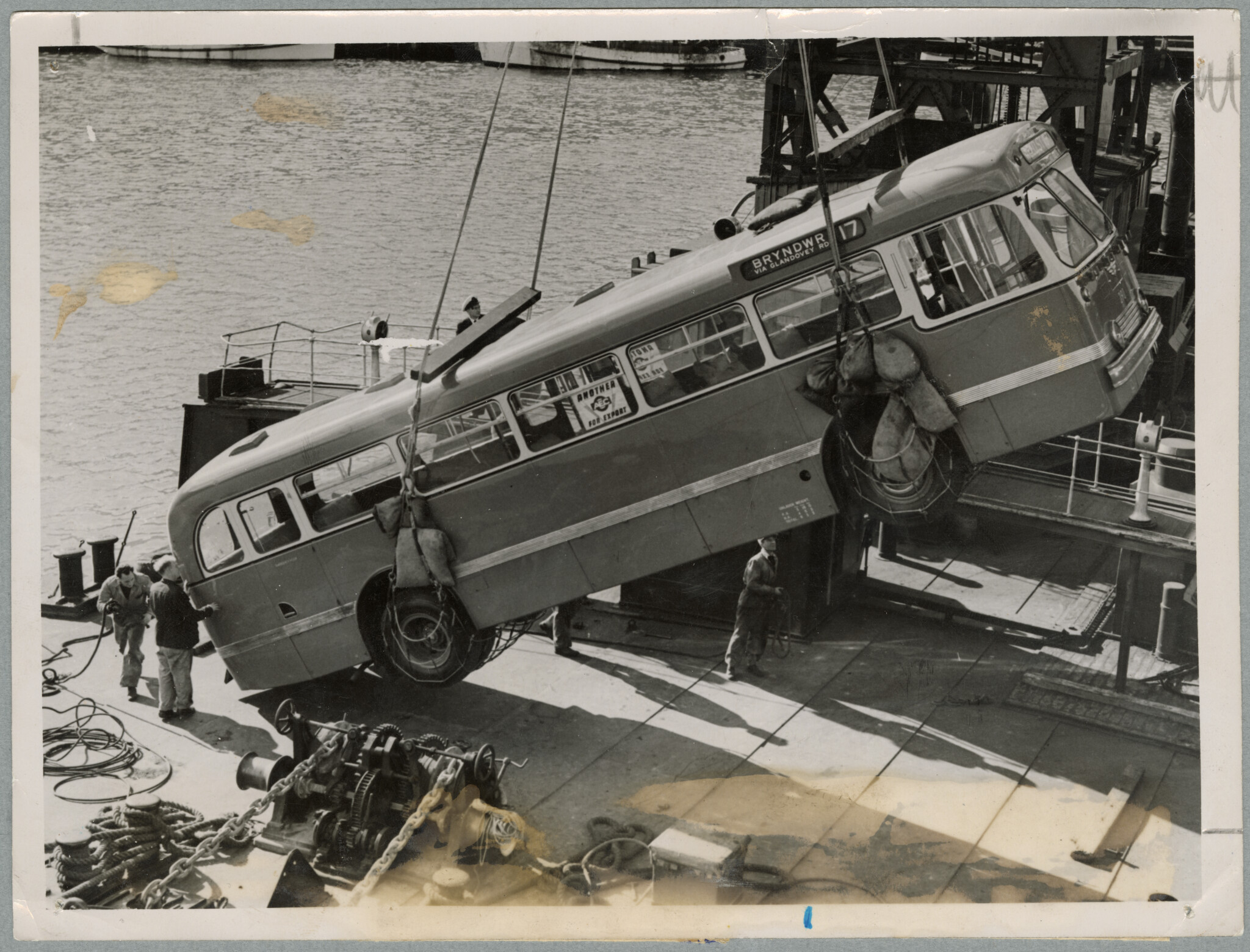 Unloading the new diesel bus. 2 August 1954. Christchurch Star archive. In copyright. CCL-StarP-04189A.